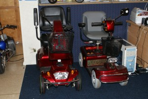 2 red second hand mobility scooters