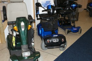 blue and green reconditioned mobility scooters